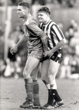 Vinnie Jones grabs Gazza's bollocks.