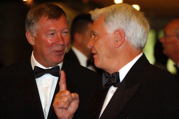 Sir Alex Ferguson and Sir Bobby Robson share an inside joke.