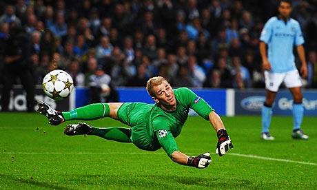 Manchester City's Joe Hart makes a save against Borussia Dortmund
