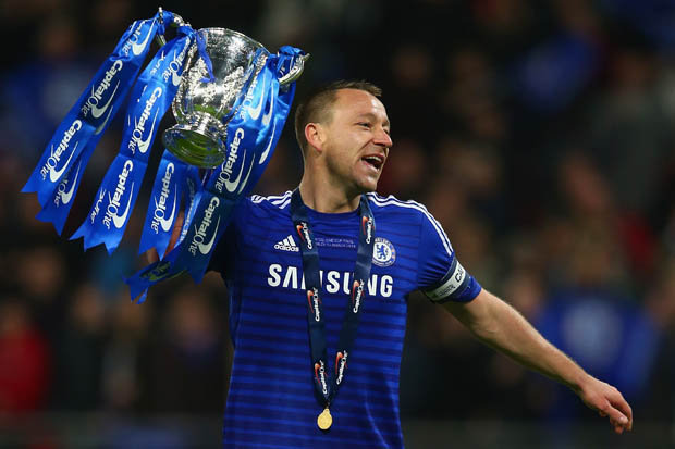 Reborn John Terry lifts the capital one cup after win against Tottenham.